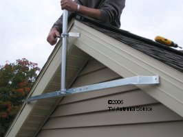 TV antenna eave mount installing the lower bracket